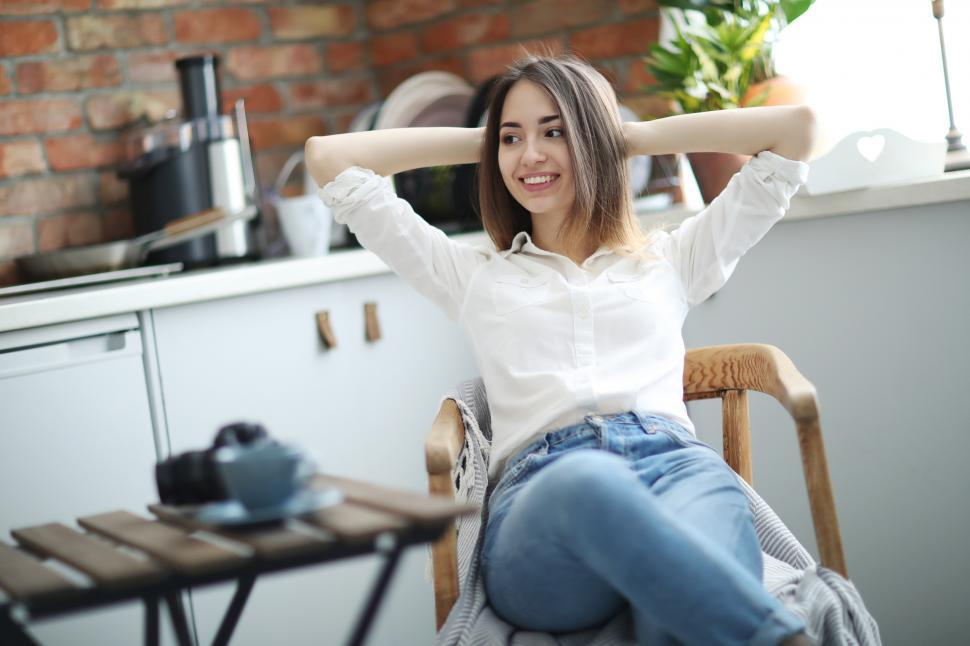 Download Free Stock Photo of Woman with hands clasped behind her head