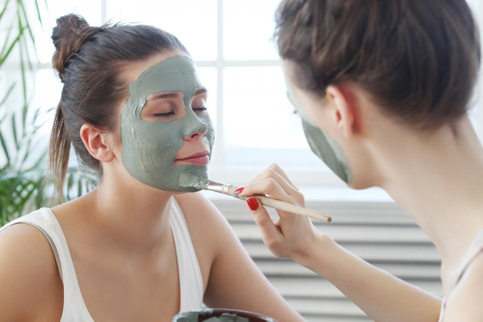 Download Free Stock Photo of Applying facial mask