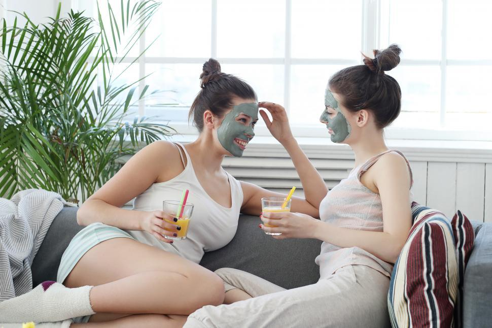 Download Free Stock Photo of Women laugh together with face masks