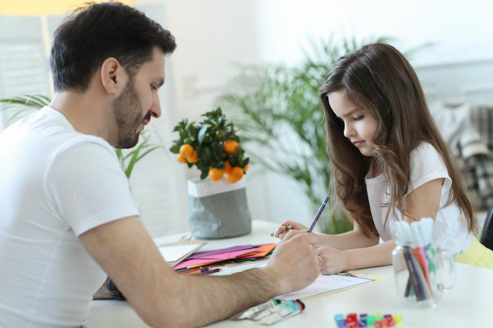 Download Free Stock Photo of Father and Daughter Drawing Together