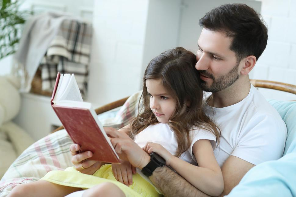 Download Free Stock Photo of Man reading to his daughter