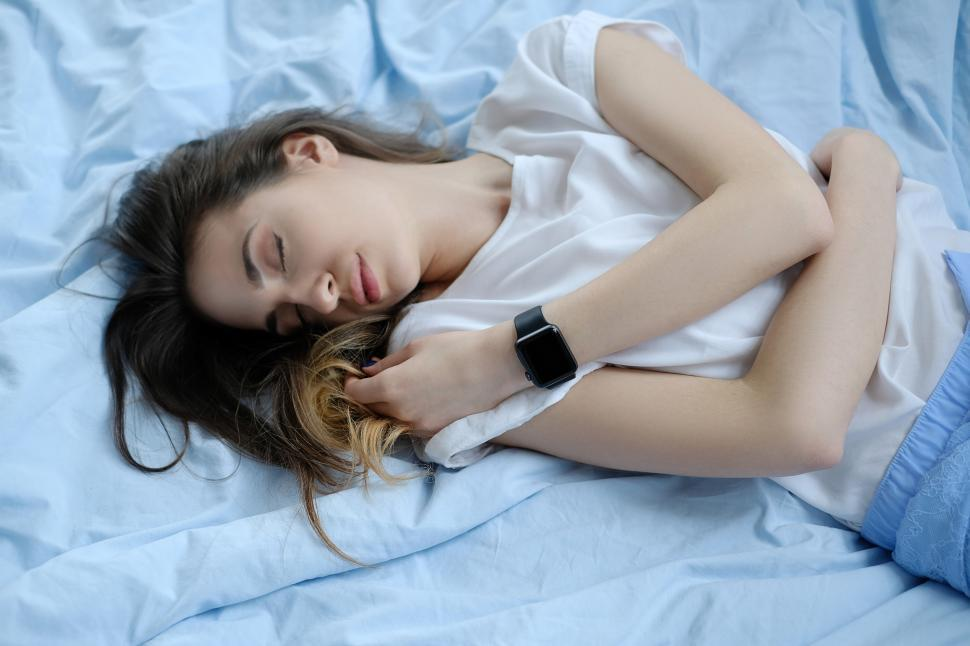 Download Free Stock Photo of Woman sleeping, with smartwatch