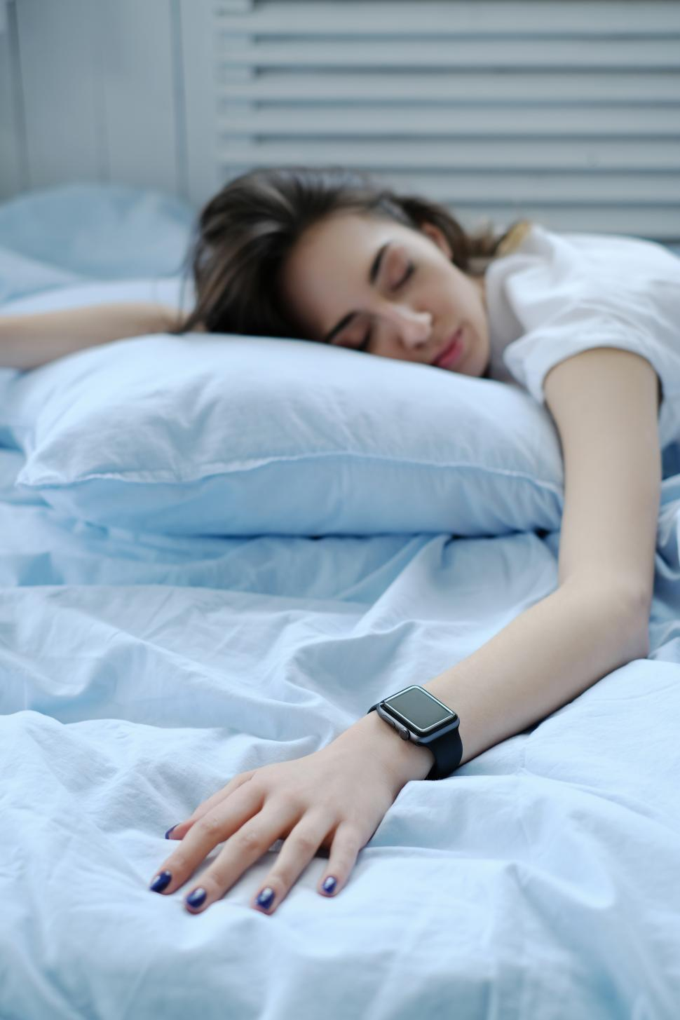 Download Free Stock Photo of Woman with smart watch on her wrist, in bed