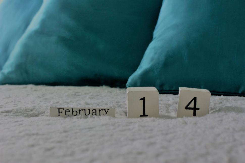 Download Free Stock Photo of Valentine's day calendar numbers on a bed