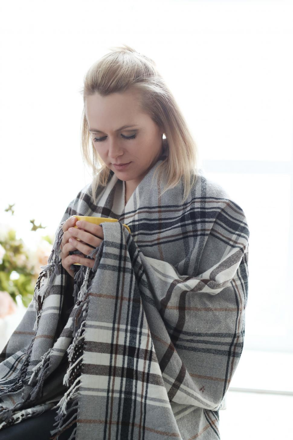 Download Free Stock Photo of Woman wrapped in blanket