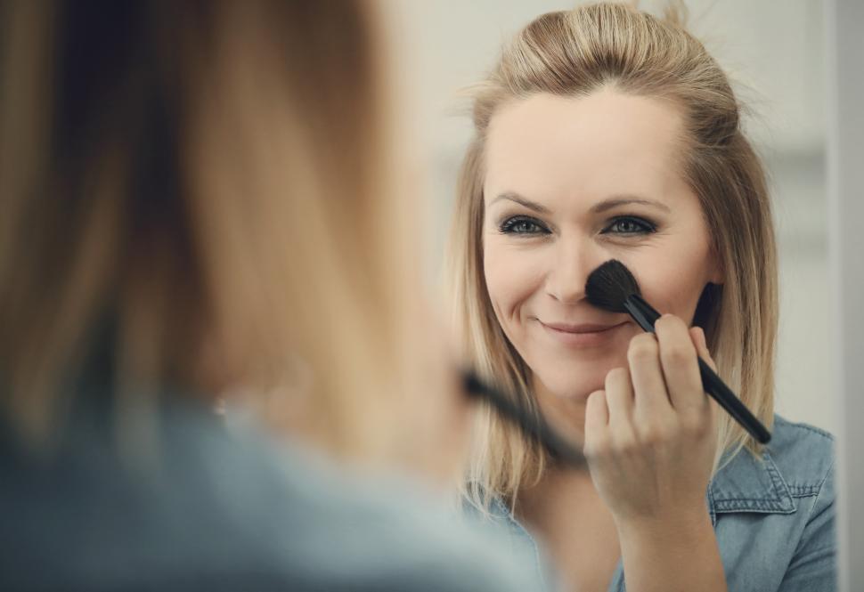 Download Free Stock Photo of Woman using makeup brush