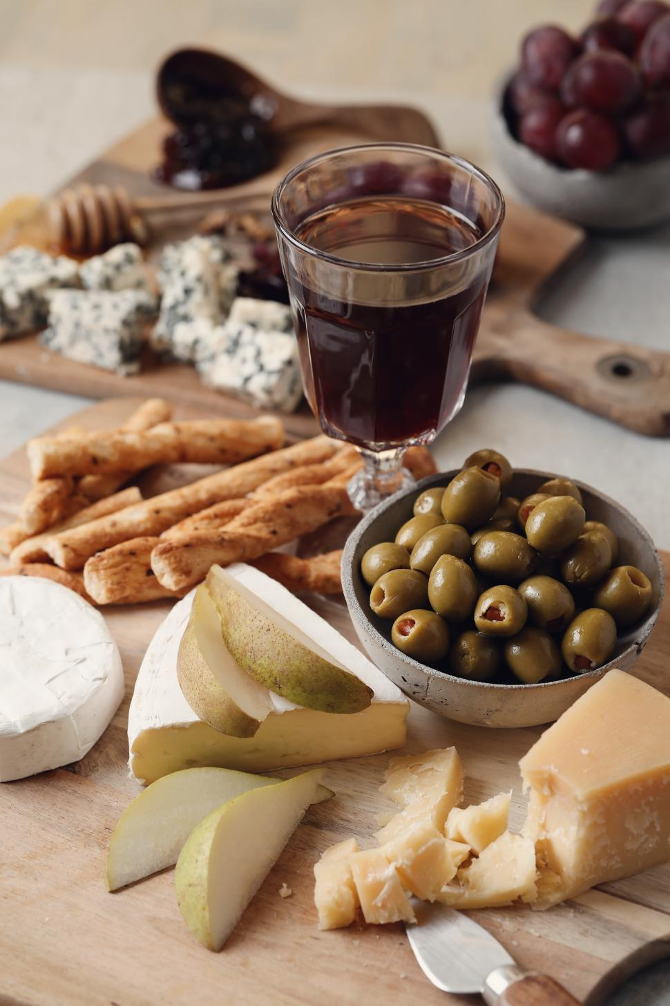 Download Free Stock Photo of Cheese and olive snack board