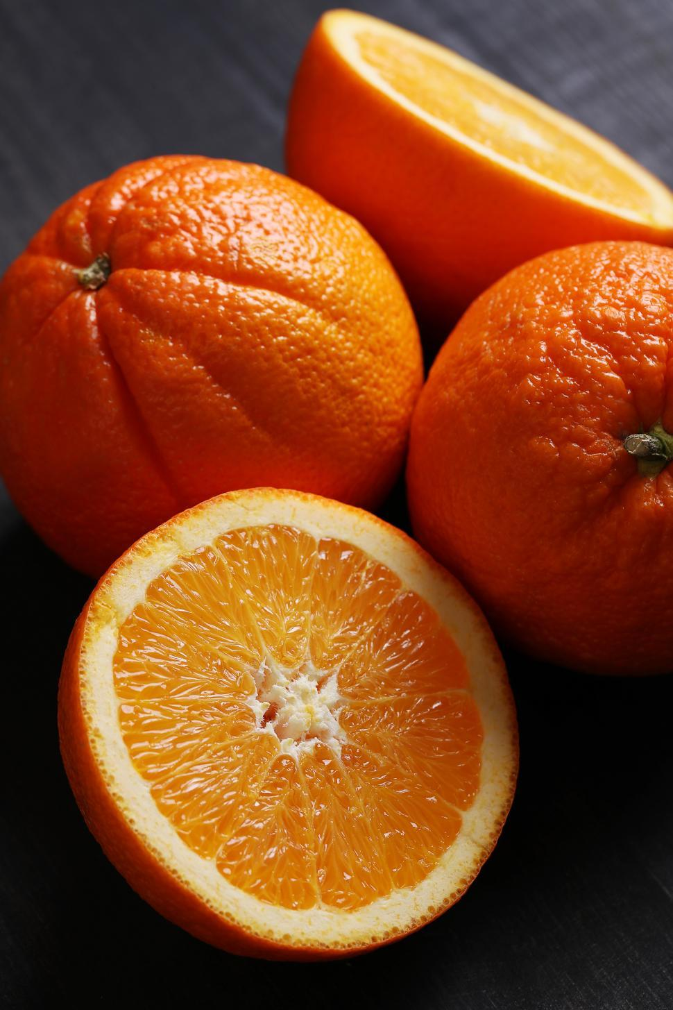 Download Free Stock Photo of Oranges, whole and halved