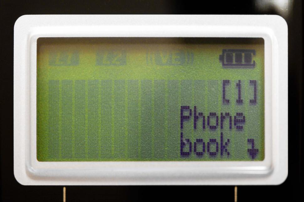 Download Free Stock Photo of screen display readout phone book lcd battery meters lines arrows telephone electronics