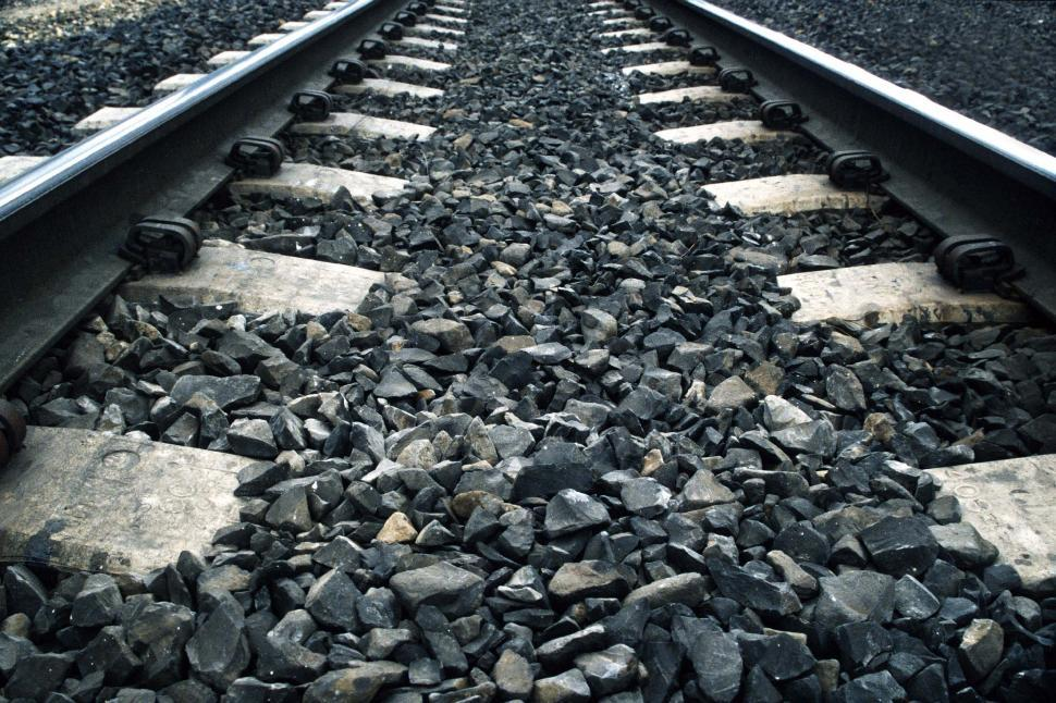 Download Free Stock HD Photo of Train Tracks on Solid Gravel  Online