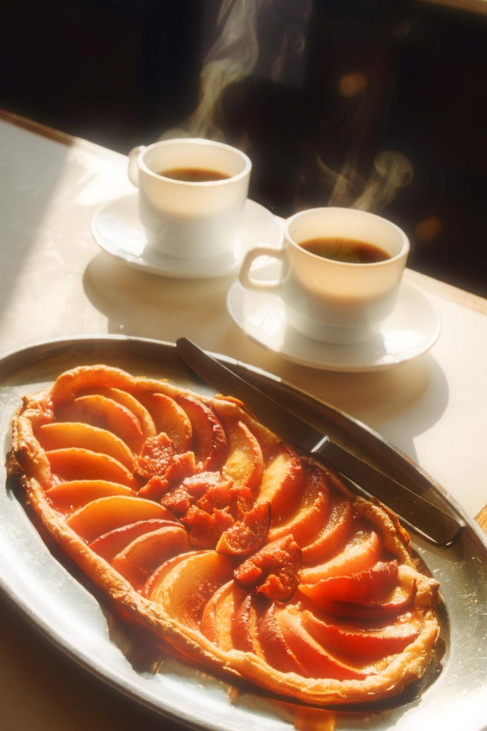 Download Free Stock HD Photo of Peach Tart with Two Cups of Cofee Online