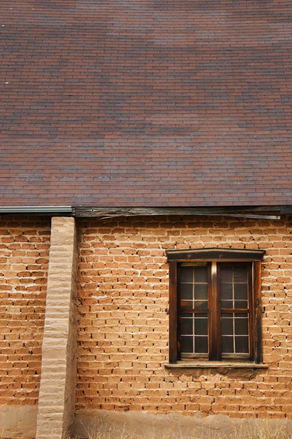 Download Free Stock Photo of adobe walls roof sloped windows wooden old bricks blocks mortar building shingled shingles gutters reinforced