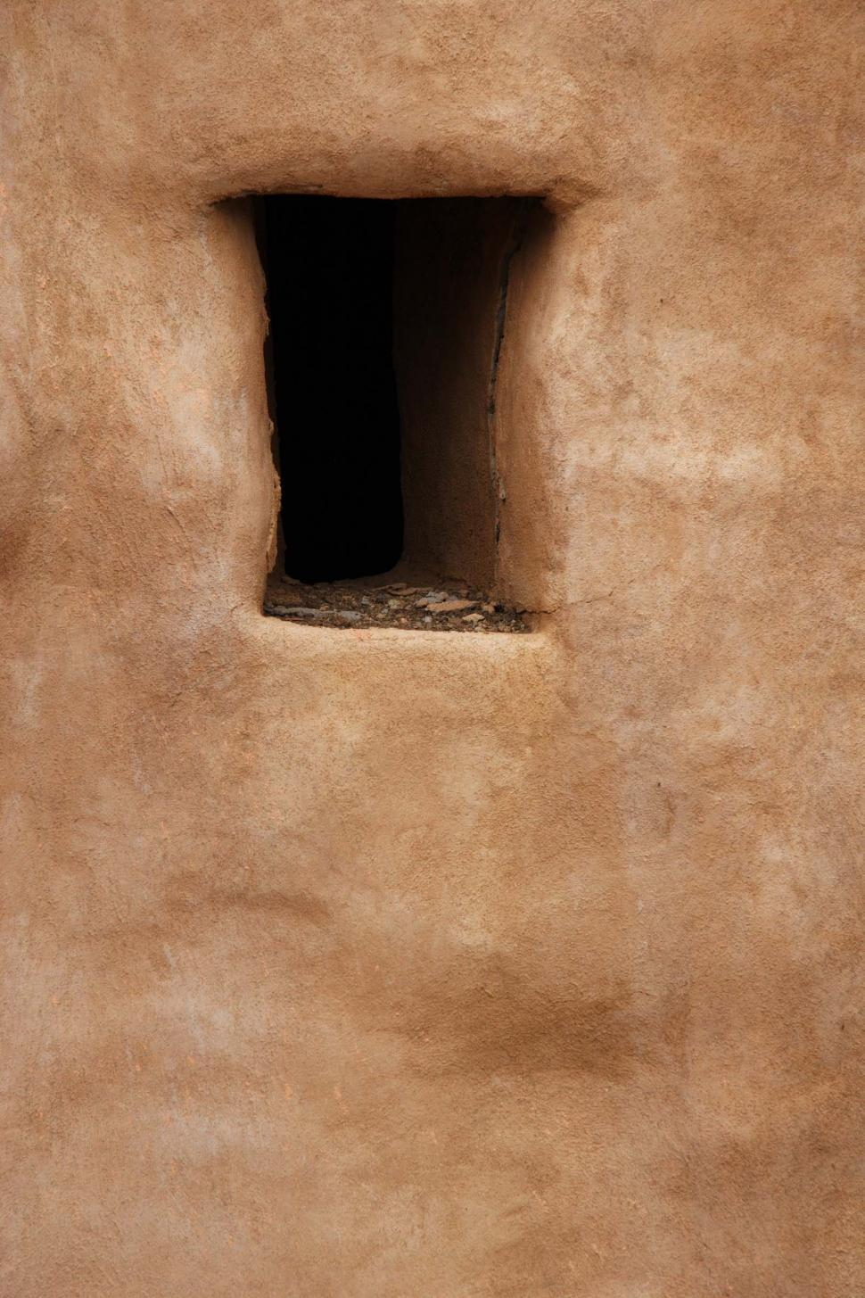 Download Free Stock Photo of Opening in stucco adobe wall