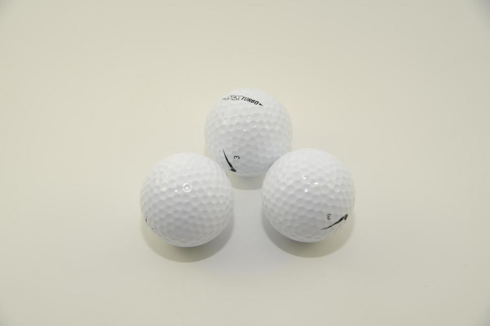 Download Free Stock Photo of Golf Balls on white background