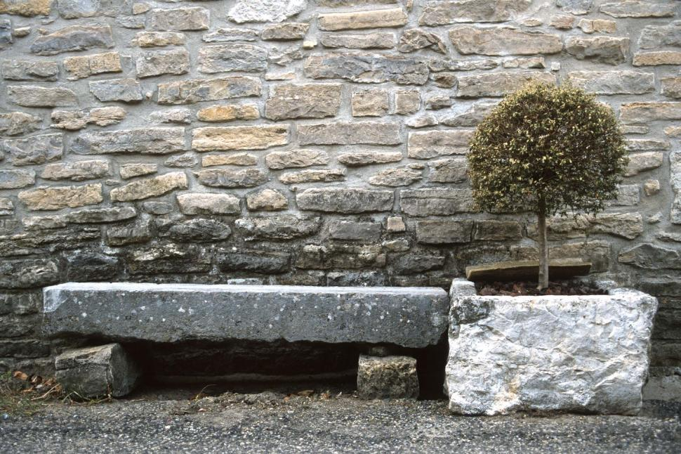 Download Free Stock HD Photo of Small stone bench and shrub tree Online
