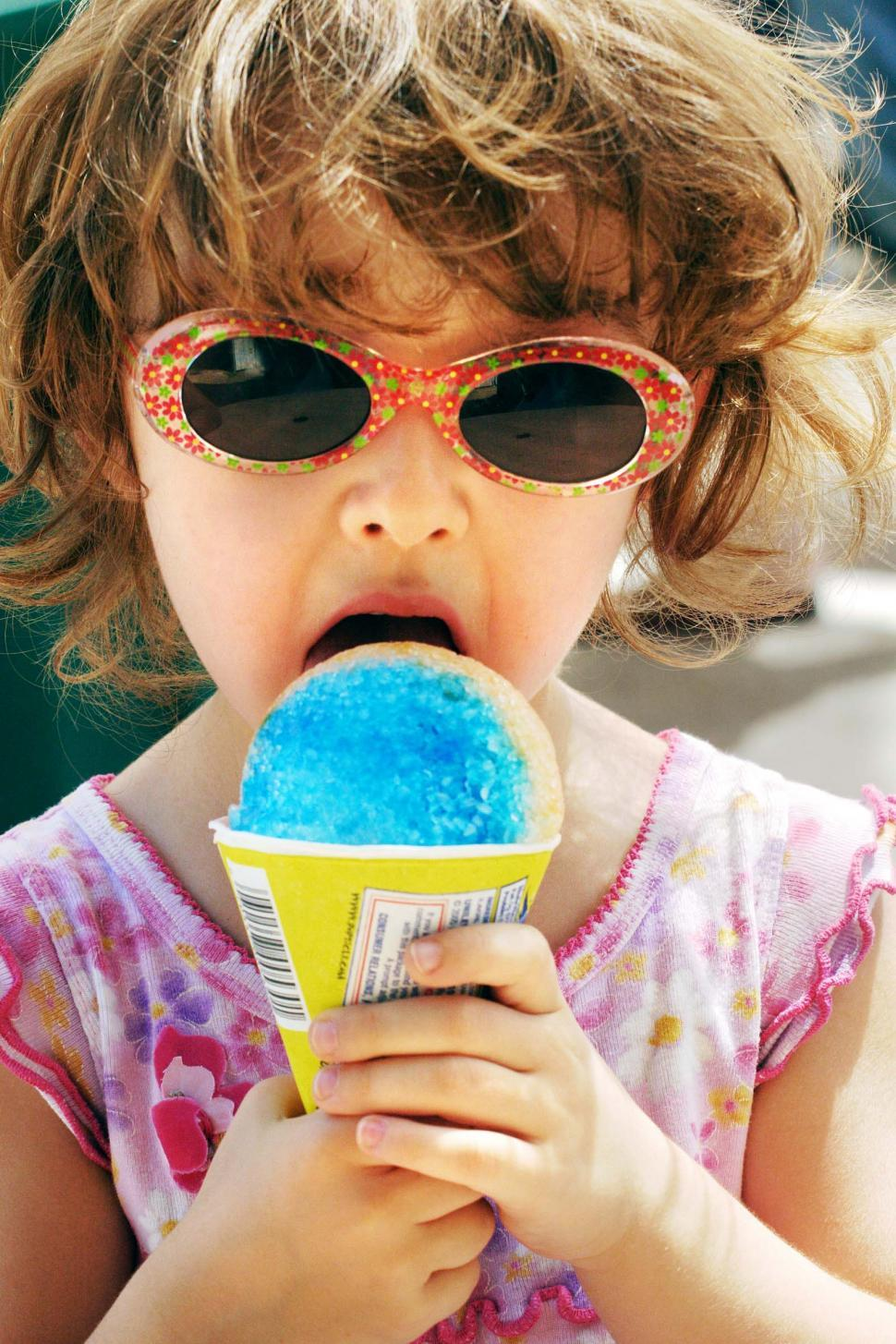 Download Free Stock Photo of Child eats snow cone