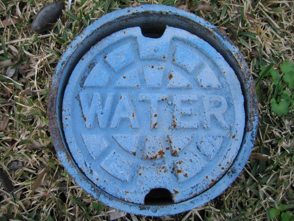 Download Free Stock Photo of Water Meter Cover
