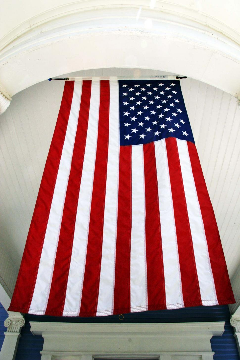 Download Free Stock Photo of Tall American Flag hanging