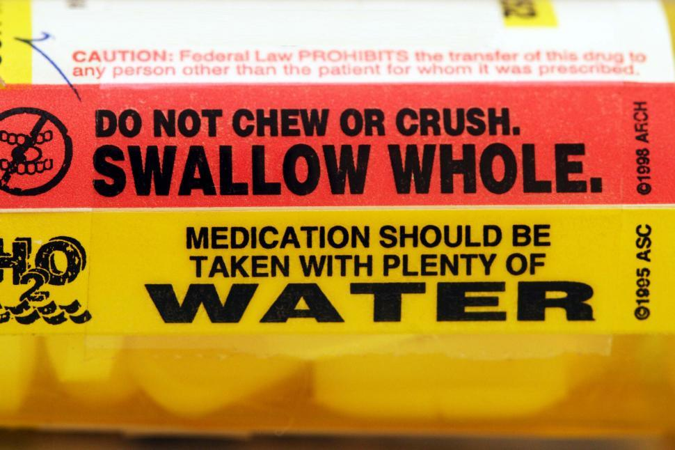 Download Free Stock Photo of Warnings on a pharmaceutical bottle