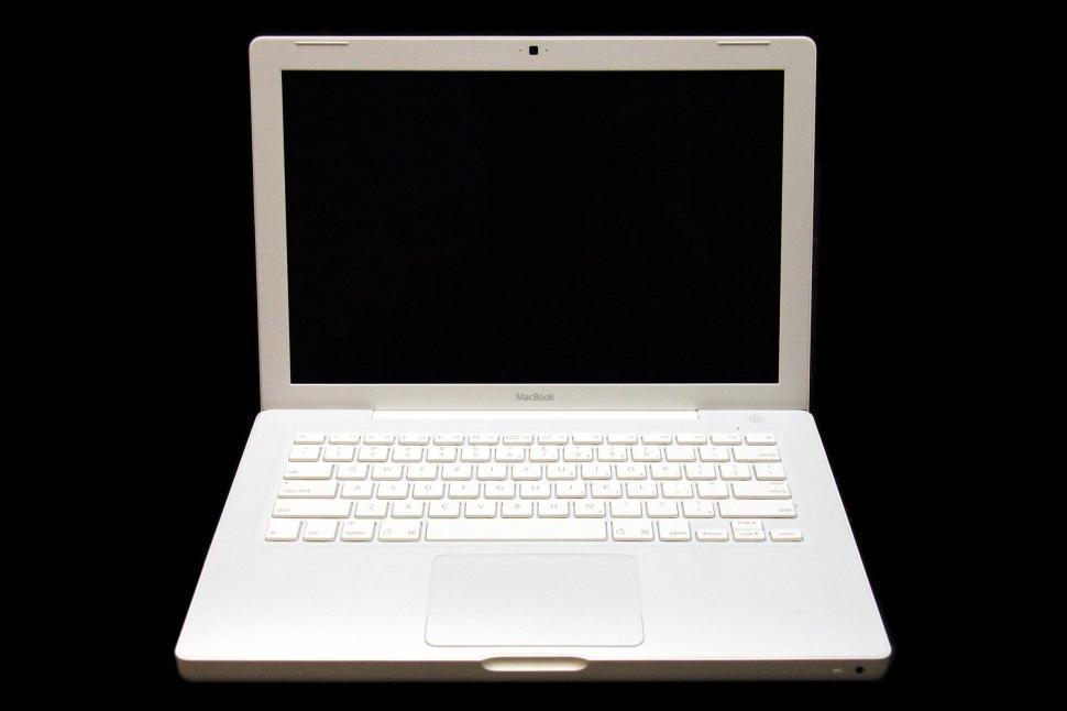Download Free Stock Photo of apple macbook laptop computer keyboard technology macintosh screen monitor keys trackpad open
