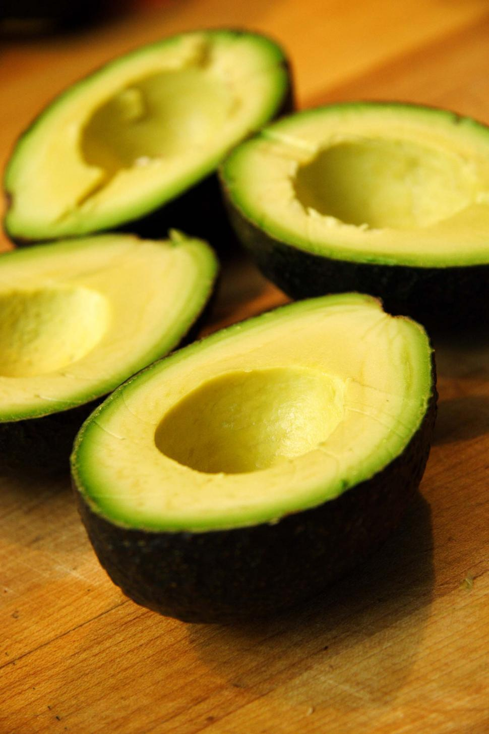 Download Free Stock Photo of Four avocado halves