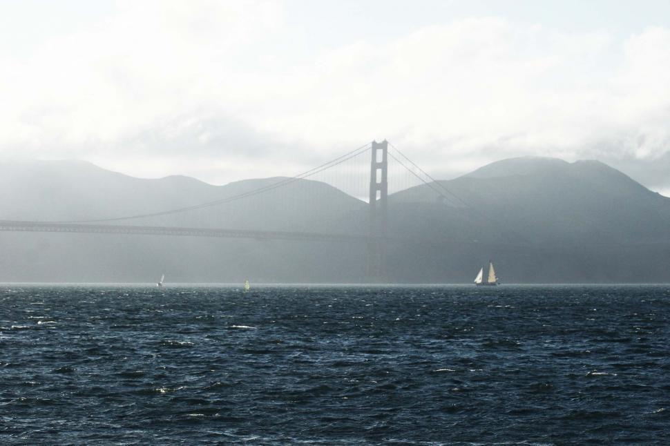Download Free Stock HD Photo of Distant Golden Gate Bridge in fog Online