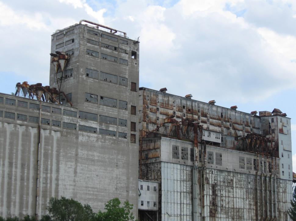 Download Free Stock HD Photo of Closed Factory, broken windows and rusted vents Online