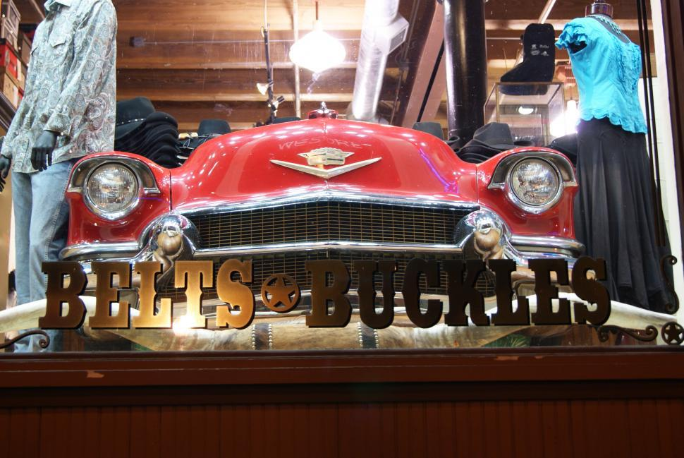 Download Free Stock Photo of Belts and Buckles store front with old car in the window