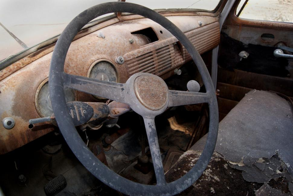 Download Free Stock Photo of Inside an old rusted car