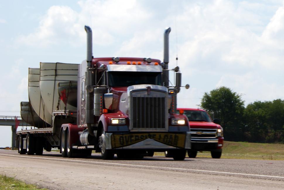 Download Free Stock Photo of 18-wheeler semi-trucks driving down Interstate Highway