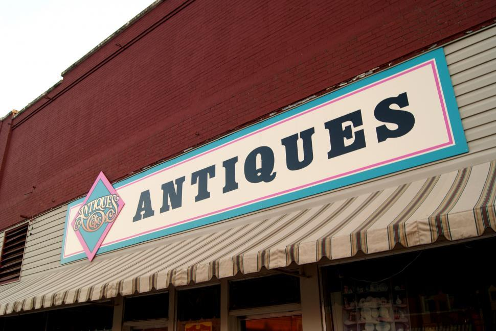 Download Free Stock Photo of Antique Shop Sign in Shopping Street
