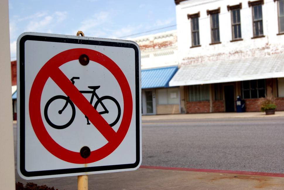 Download Free Stock Photo of No Bicycles Allowed sign in old downtown
