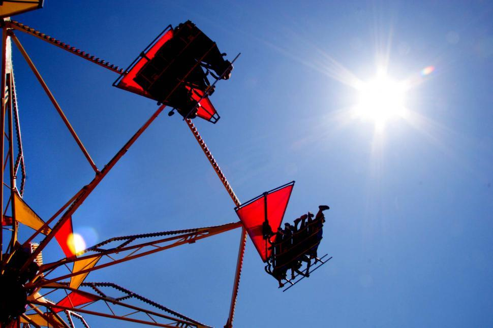 Download Free Stock Photo of Amusement ride in the sun