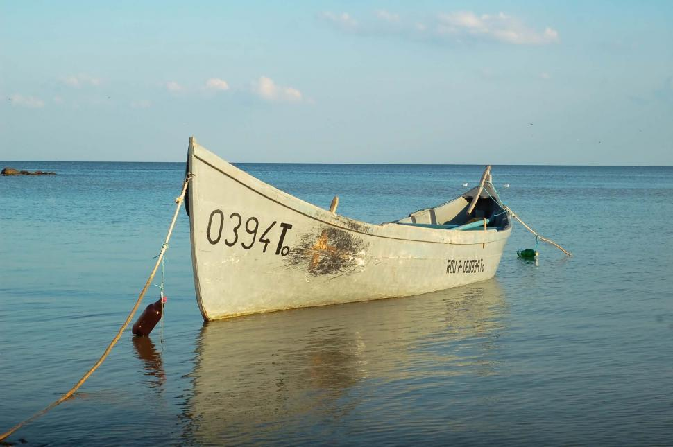 Download Free Stock HD Photo of row boat over sea Online