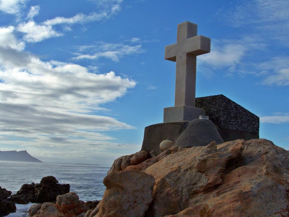 Download Free Stock Photo of marble cross ontop of hill overlooking Kleinemond bay in South africa