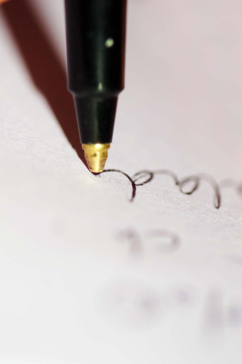 Download Free Stock HD Photo of Closeup of pen point as writing flows Online