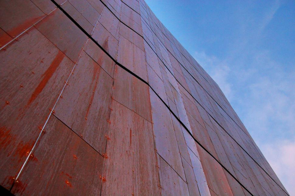 Download Free Stock HD Photo of Looking up at a copper wall Online