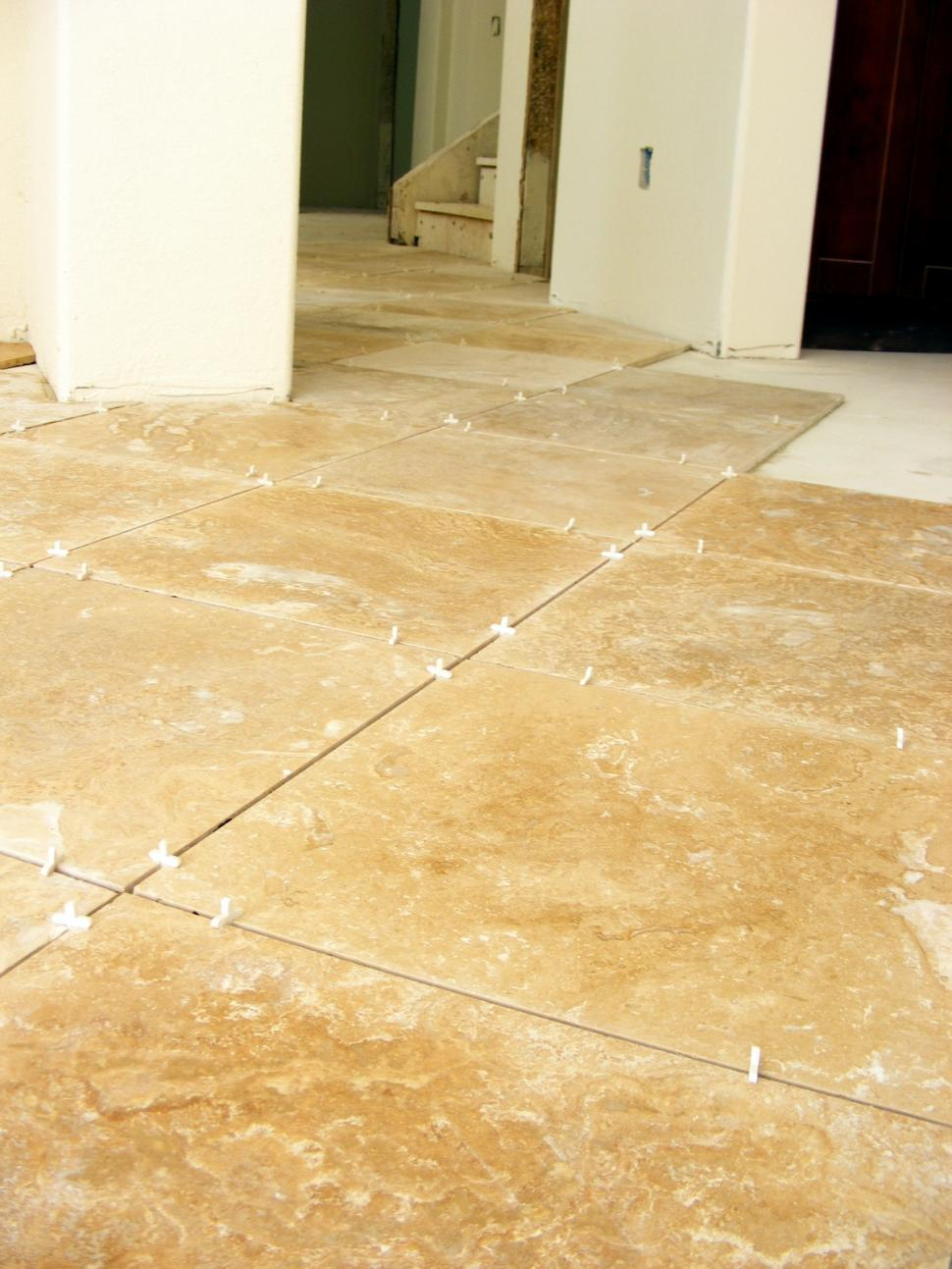 Download Free Stock Photo of Working With Tile Floors