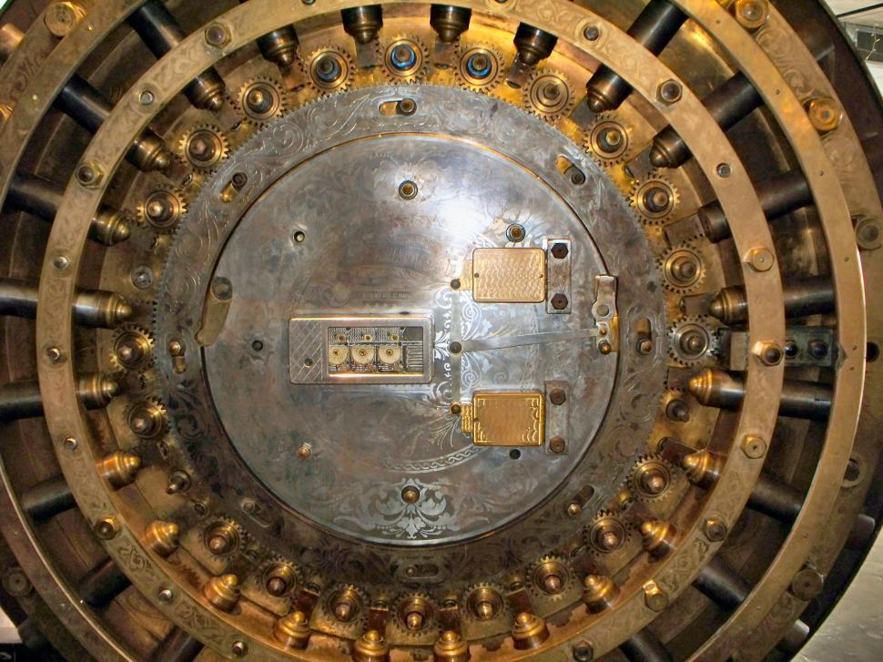 Download Free Stock Photo of Inner working of an old bank safe door