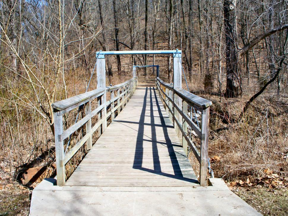 Download Free Stock Photo of Long wood foot bridge crossing over a creek