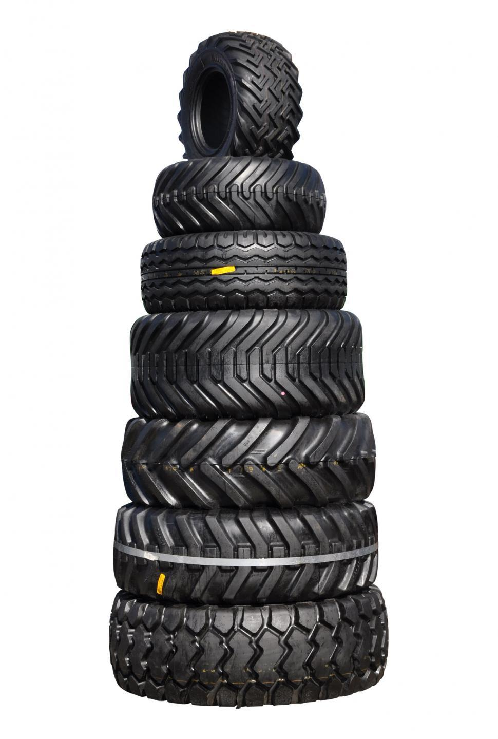Download Free Stock HD Photo of Pile of tractor tyres Online