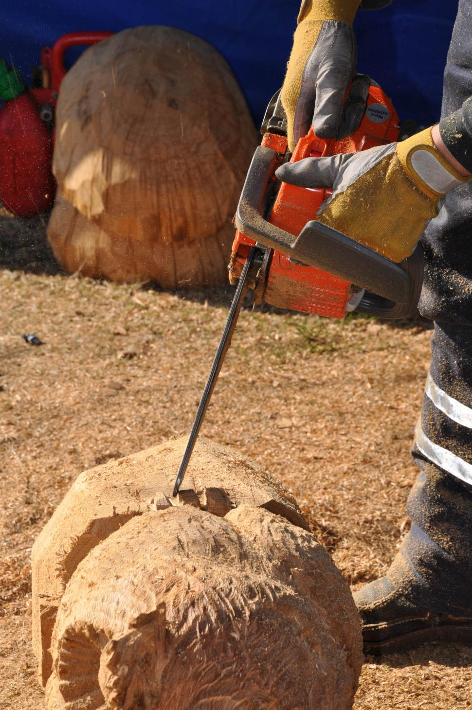 Download Free Stock Photo of Craftsman is working with chainsaw