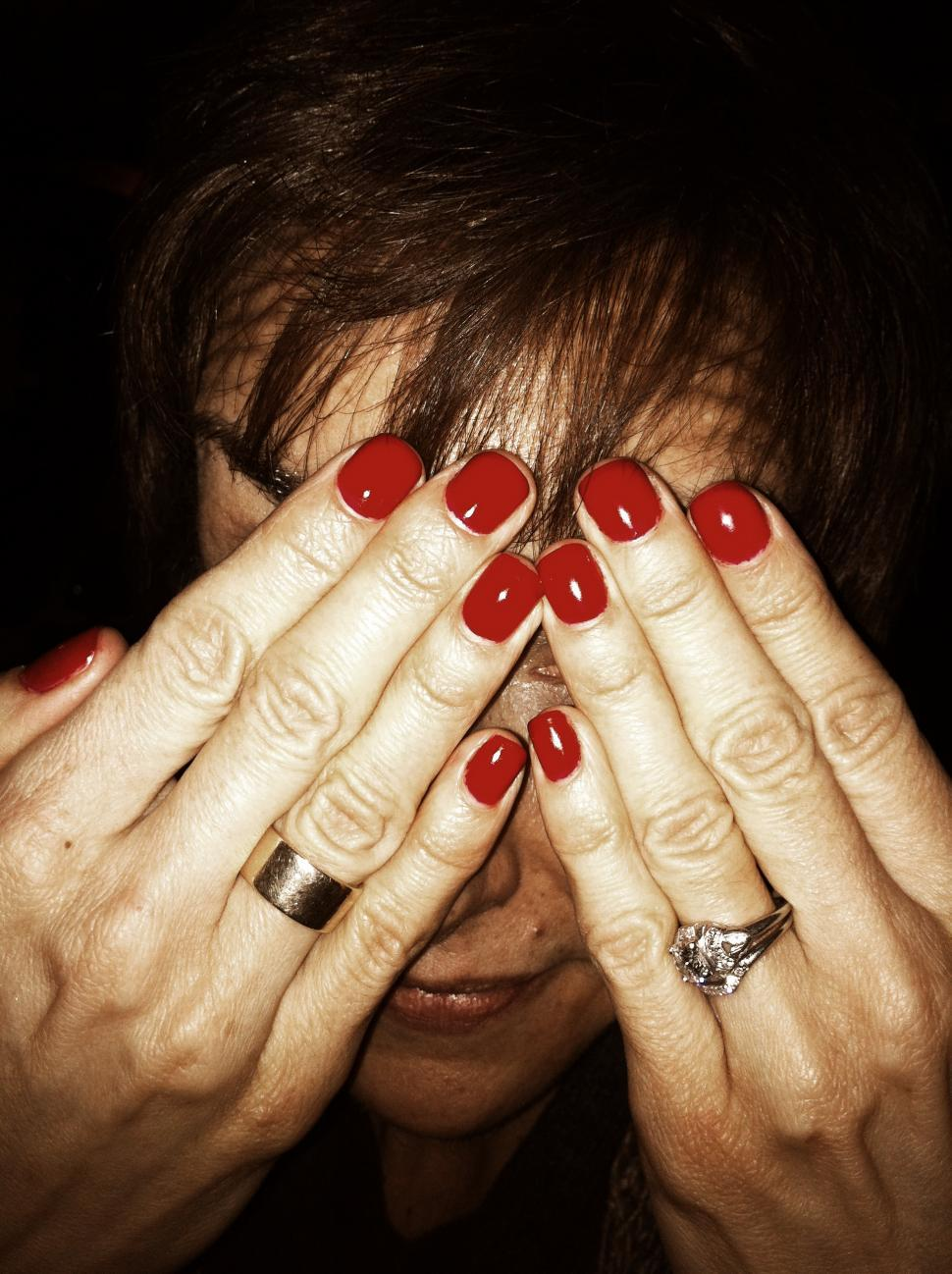 Download Free Stock HD Photo of Woman Hiding Behind Manicure Online