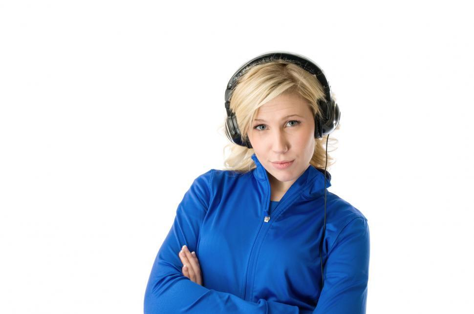 Download Free Stock Photo of Womans in headphones looks a camera