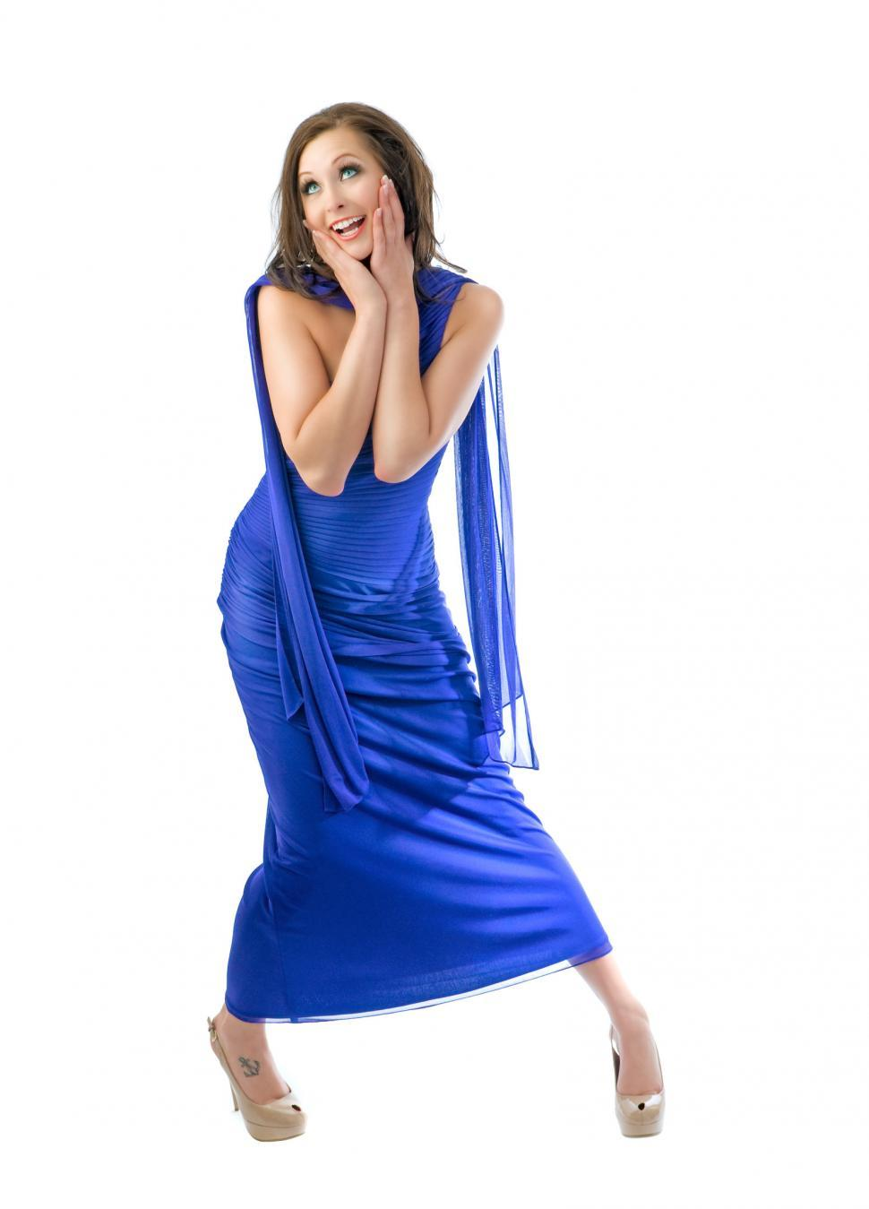 Download Free Stock Photo of Young woman in blue dress is excited