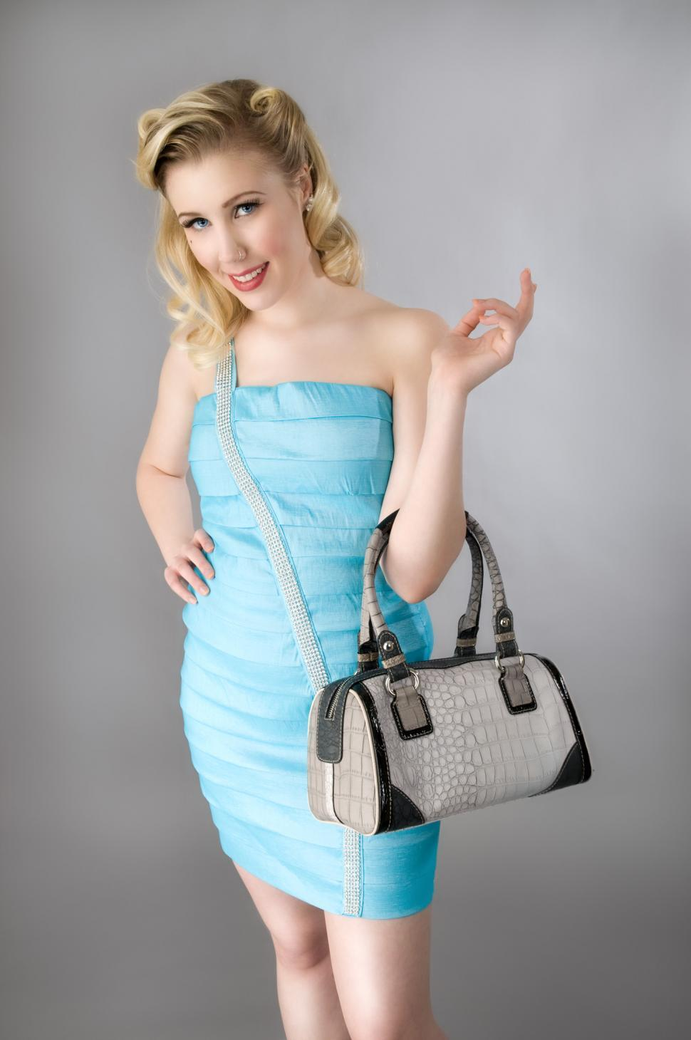 Download Free Stock HD Photo of Young woman with handbag Online
