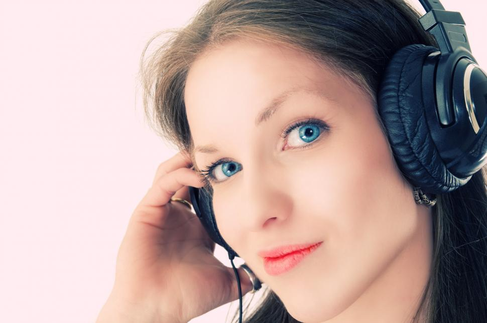 Download Free Stock Photo of Young woman listening to music