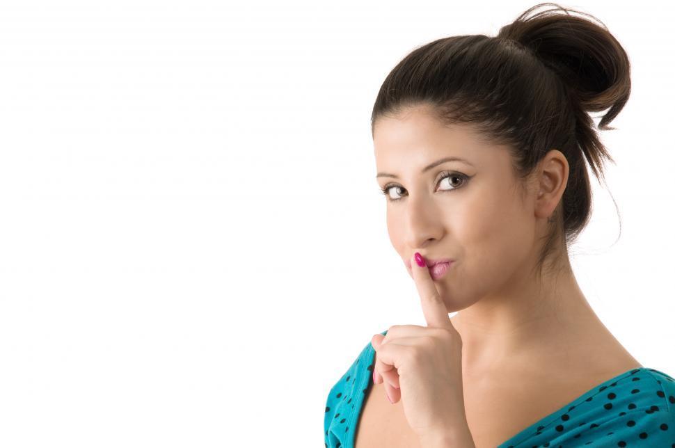 Download Free Stock Photo of Young woman shushing