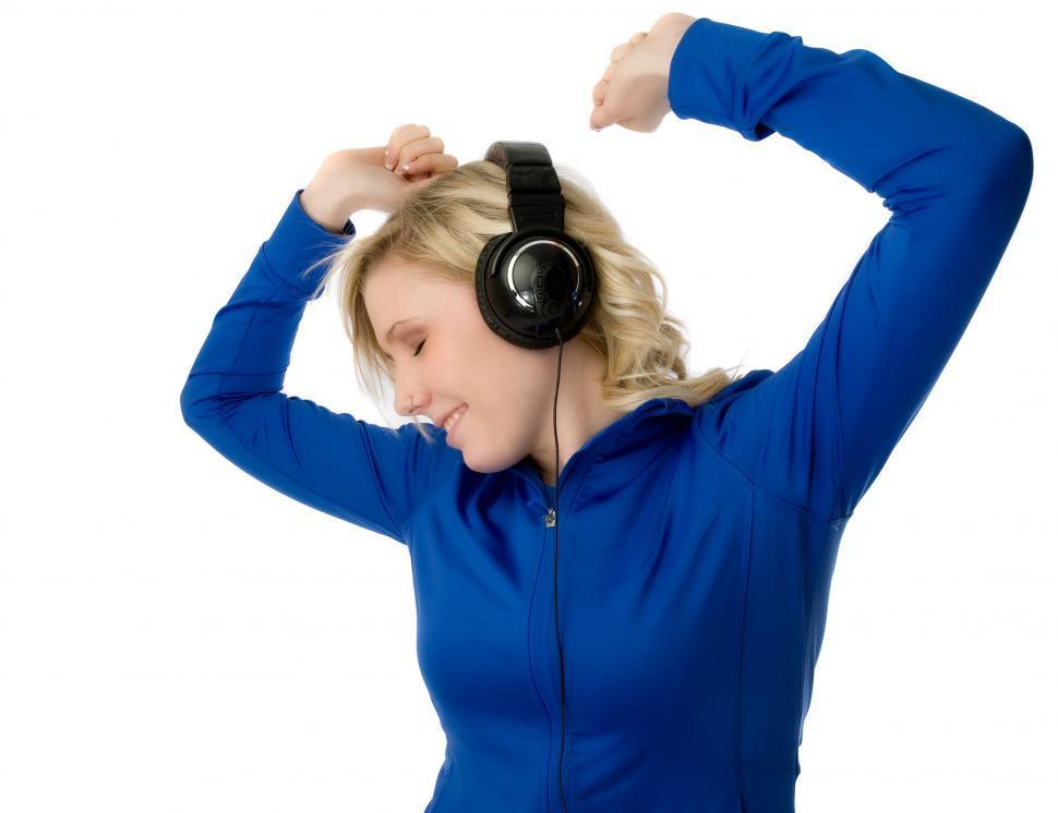 Download Free Stock HD Photo of Young woman dancing in headphones Online
