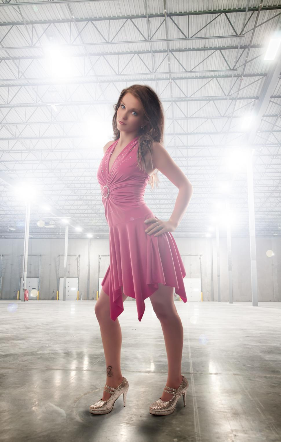 Download Free Stock HD Photo of Model in empty warehouse Online